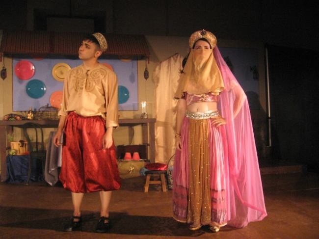 Aladdin (l- Sam Hayder) and Princess Opal (r- Amy Greco) encountering each other on the streets of Baghdad.