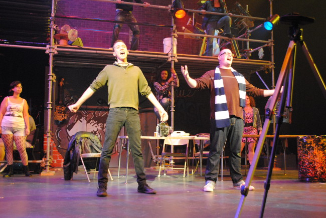 Roger (l- Dvid Woodward) and Mark (r- Jake Stuart) in Phoenix Festival Theatre's production of Rent.