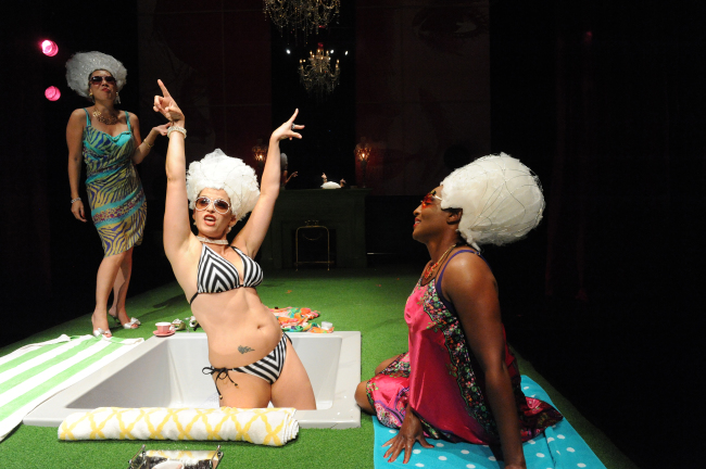 (l to r) Therese de Lamballe (Sue Jin Song) Marie Antoinette (Kimberly Gilbert) and Yolande de Polignac (Dawn Ursula) sunning themselves in a lavish fashion in the opening scene of Marie Antoinette at Woolly Mammoth Theatre Company
