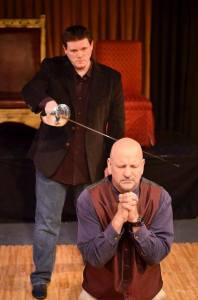Hamlet (Michael J. Dombroski) ready to strike vengeance upon Claudius (William Cassidy) for the murder of King Hamlet