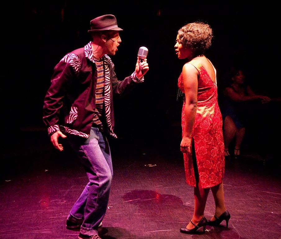 Huey Calhoun (L- Greg Twomey) and Felicia Farrell (R- Ashley Lauren Johnson) meet in Delray's club for the first time.