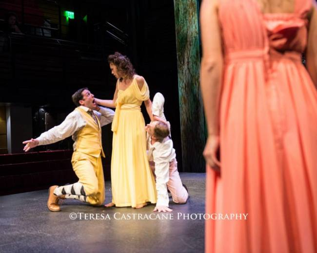 (l to r) Demetrius (James Jager) Helena (Audrey Bertaux) Lysander (Travis Hudson) and the backside of Hermia (Rachel Jacobs) in A Midsummer Night's Dream at Chesapeake Shakespeare Company