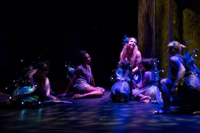 Titania, Queen of the Fairies (center- Kathryn Elizabeth Kelly) holds court with her fairies in A Midsummer Night's Dream at Chesapeake Shakespeare Company
