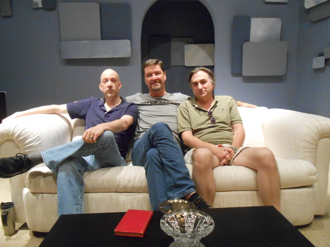 Three Best Buds sitting on set in Serge's living room early on a Sunday morning. From the left- Eric C. Stein, Steven Shriner, and Mark Scharf discuss their current production of Art at the Vagabond Players.