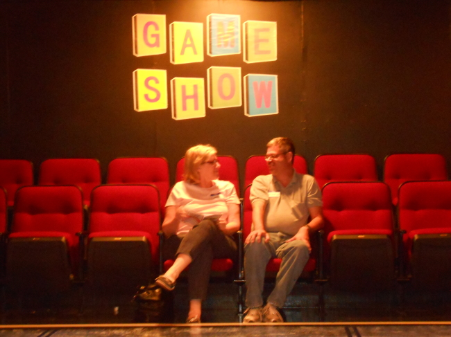 "Eager audience members await the official start of ""Game Show"" at Spotlighters Theatre"