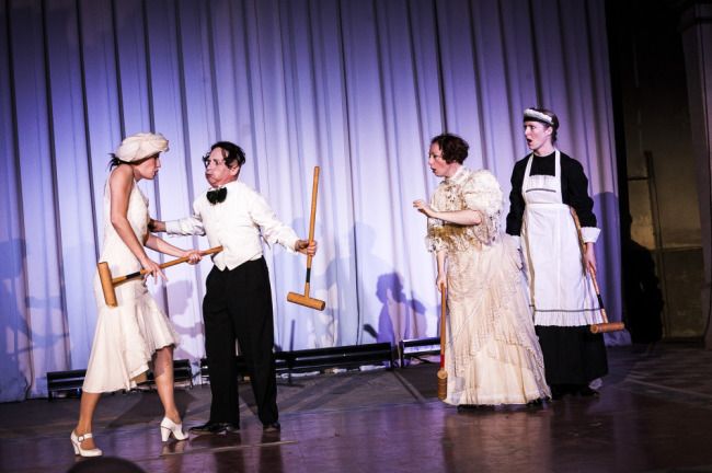 The rules of Croquet as explained by Happenstance Theatre (l to r) Sarah Olmsted Thomas, Mark Jaster, Sabrina Mandell, and Gwen Grastorf