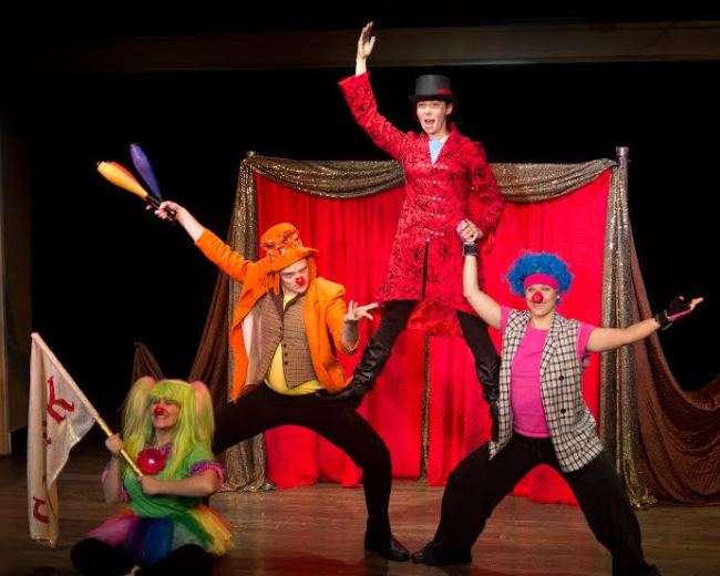The ensemble of Not My Monkey: featured left to right The Green Clown (Sarah King) The Orange Clown (Jack Novak) Ringmaster Tekla (Anna Jackson) and The Pink Clown (Alani Kravitz)