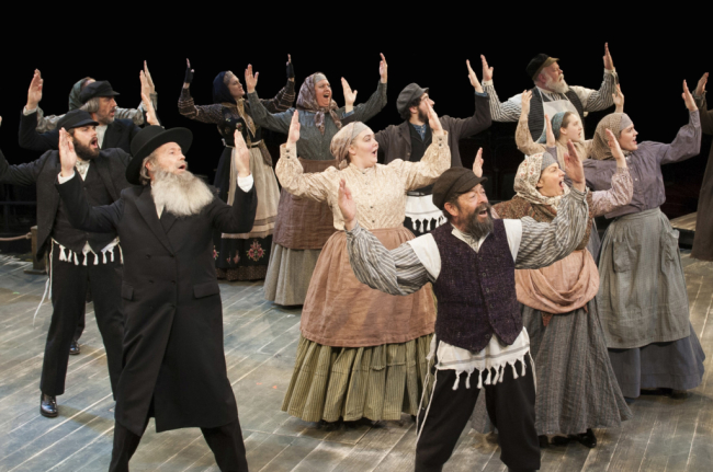 Jonathan Hadary as Tevye and the company of Fiddler on the Roof at Arena Stage at the Mead Center for American Theater October 31, 2014-January 4, 2015.