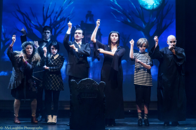 "The Addams Family (from l to r) Liz Weber (Grandma), David ""DJ"" Wojciekowski (Lurch), Camryn Shegogue (Wednesday), Bobby Libby (Gomez), Laura O'Brien (Morticia), John Ray (Pugsley), and Chuck Dluhy (Fester)."