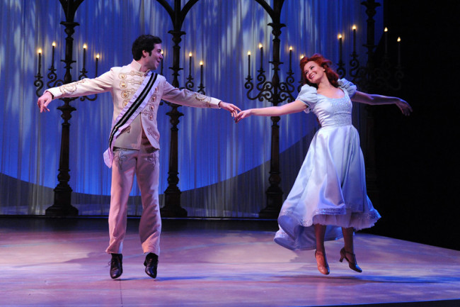 Prince Eric (Joe Chisholm) teaches Ariel (Lara Zinn) how to dance.