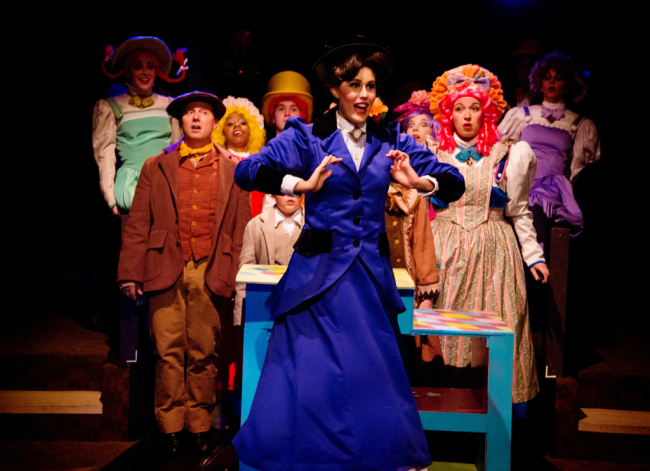 """Mary Poppins (Center- Maura Hogan) with Bert (Front Left- Jeffrey Shankle) and Mrs. Corry (Front Right- Coby Kay Callahan) about to sing """"Supercalifragilisticexpialidocious"""""""