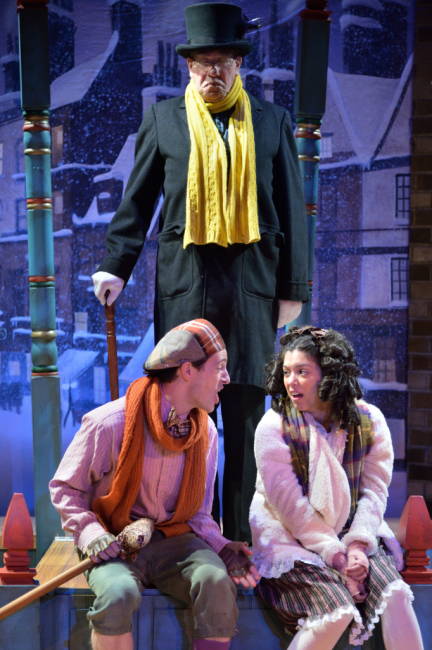 Chris Dinolfo as Tiny Tim and Brittany Martz as Charlotte make plans to play a trick on Scrooge.