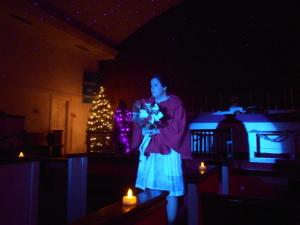 "Lauren Giglio as Belle performing ""Blue Christmas"""