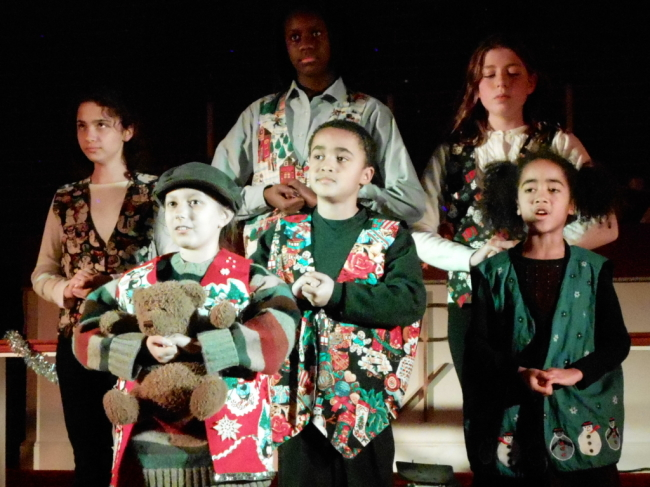 (l to r) Hope Cratchit (Emilee Schmidt) Tiny Tim (Sophia Nasreen Riazi-Sekowski) Little Boy (Malachi Wilson) April (KiAnna Nycole Dorsey) Joy Cratchit (Samantha Roberts) and Little Girl (Simone Wilson)
