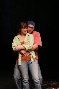 Sarah (L- Kathryn Zoerb) and Brian (R- Travis Hudson) embrace in Sarah's front yard.