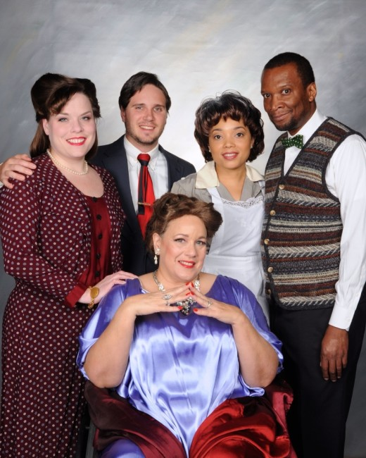 The cast of the Vagabond Players production of Interlock from Left to Right: Hilde (Karina Ferry) Paul (Rick Lyon-Vaiden) Mrs. Price (Laura Gifford) Lucille (Lisa Walker) and Everett (Grant Chism)