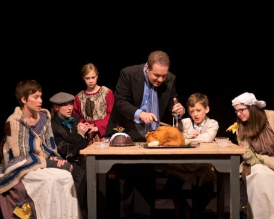 Cratchit Family from Left to Right: Gladys Cratchit (Julie Zito), Tiny Tim (Maria O'Connor), Child 1 (Kathryn LaLonde), Bob Cratchit (Peter J. Orvetti), Child 2 (Aidan Emerson), and Little Nell (Maggie Murphy).