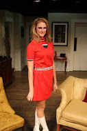 Cory Bolcik as TWA airline stewardess Janet