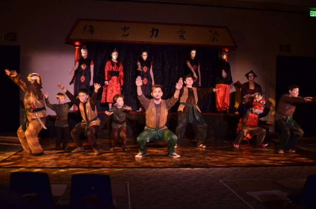 Captain Shang (C- Jake Zeranko) and the Chinese Soldiers prepare for War as the Ancestors (background) watch on.