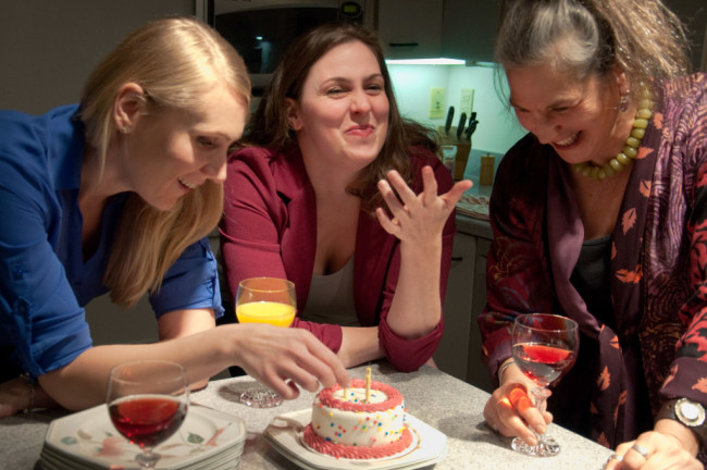 Becca (L- Zarah Rautell), Izzy (C- Ryan Gunning), and Nat (R- Amy Jo Shapiro) share cake for Izzy's birthday