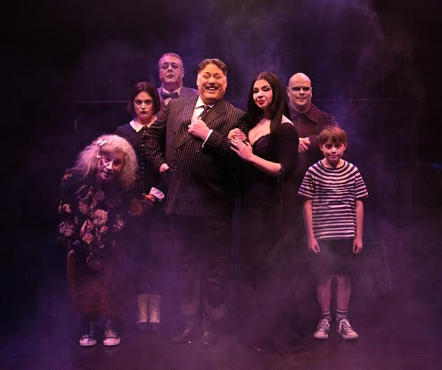 (L to R) The Addams Family: David James as Grandma, MaryKate Brouillet as Wednesday, David Bosley-Reynolds as Lurch, Lawrence B. Munsey as Gomez, Priscilla Cuellar as Moricia, Shawn Kettering as Uncle Fester, and Gavin Willard as Pugsley
