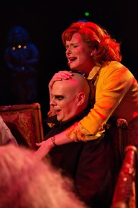 Uncle Fester (L- Shawn Kettering) is embraced by Alice Beineke (R- Elizabeth Rayca) during her full disclosure at dinner.