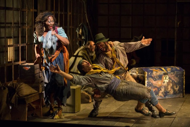 Amber Iman as Aldonza, James Hayden Rodriguez as Jose, Nathan Lucrezio as Anselmo, and Dan Sharkey as The Governor in the Shakespeare Theatre Company's production of Man of La Mancha, directed by Alan Paul
