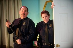 Kevin Kelehan (left) as Officer Welch and Heidi Vause (right) as Officer Pudney