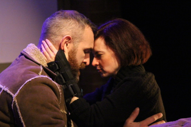 Aaron Tone as James (left) and Aly B. Ettman as Sarah (right) in Time Stands Still at Peter's Alley Theatre Productions