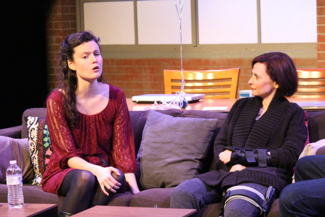 Chelsea Mayo as Mandy (left) and Aly B. Ettman as Sarah (right) in Time Stands Still at Peter's Alley Theatre Productions