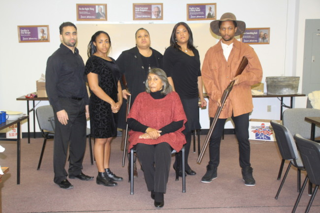 (L to R) Ben Harris as Frank Charles, Brawnlyn Blueitt as Minnie Dove Charles,  Kecia Campbell as Sophie Washington,  Lolita Marie as Fannie Dove, Darius McCall as Wil Parish. Seated is Sandra Cox True who plays Miss Leah.