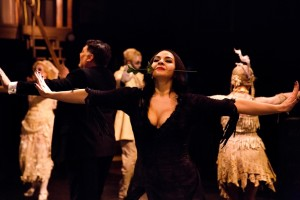 "Priscilla Cuellar as Morticia Addams (center) dancing the ""Tango De Amor"" in The Addams Family at Toby's Dinner Theatre"
