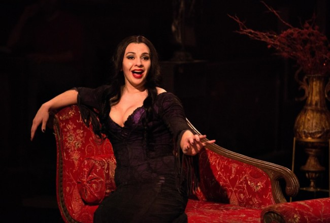 "Priscilla Cuellar as Morticia Addams singing ""Secrets"" in The Addams Family at Toby's Dinner Theatre"
