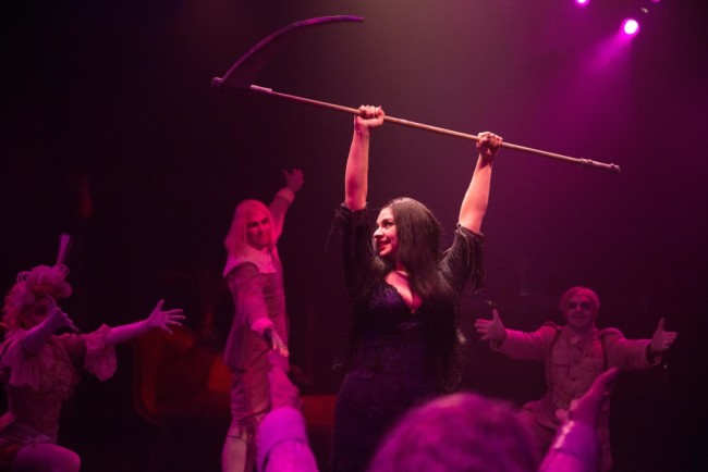 "Morticia Addams (Center, Priscilla Cuellar) dances through ""Just Around the Corner"" with the Ancestors (L to R Rachel Kemp, Ariel Messeca, and Will Emory)"