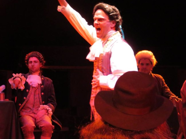 "Dan Felton as Edward Rutledge (center) singing ""Molasses to Rum"" in 1776 at Toby's Dinner Theatre"