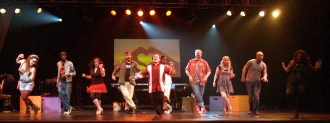 "Matt Wetzel (center) leading the company through ""We Beseech Thee"" in Godspell at Silhouette Stages"