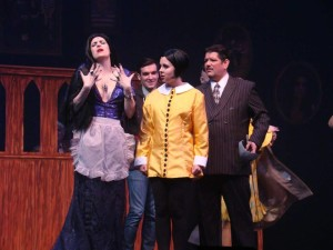 (L to R) Tatiana Dalton as Morticia Addams, James Baxter as Lucas, Allison Comotto as Wednesday Addams, and Vincent Kirk Musgrave as Gomez Addams