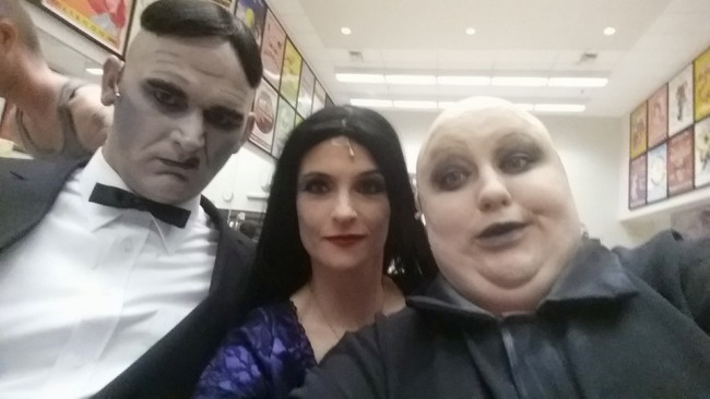 Lurch (L- Mark Lloyd) Morticia (C- Tatiana Dalton) and Uncle Fester (R- Kristen Cooley) preparing for an evening of creepy kookiness!
