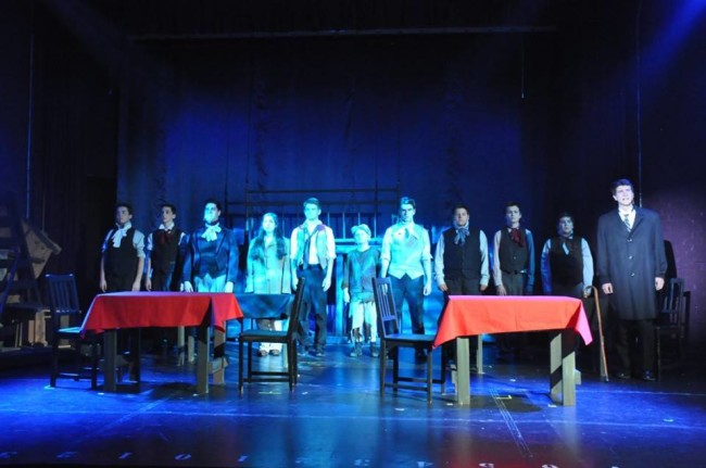 "The harrowing staging of ""Empty Chairs at Empty Tables"" by Director Liz Boyer Hunnicutt in Les Miserables"