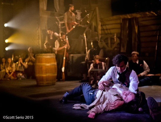 "Marius (Abu Akki) holds Eponine (Charis Latshaw) for ""A Little Fall of Rain"" in Les Miserables"