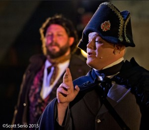 Lance Bankerd as Inspector Javert (foreground) with Lee Lewis as Jean Valjean (background) in Les Miserables