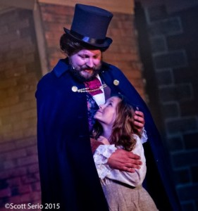 Lee Lewis (left) as Jean Valjean and Amelia Moss (right) as Little Cosette in Les Miserables