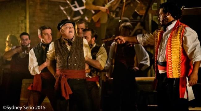 Lance Bankerd as Javert (left) with Daniel Urdaneta as Enjolras (right) in Les Miserables