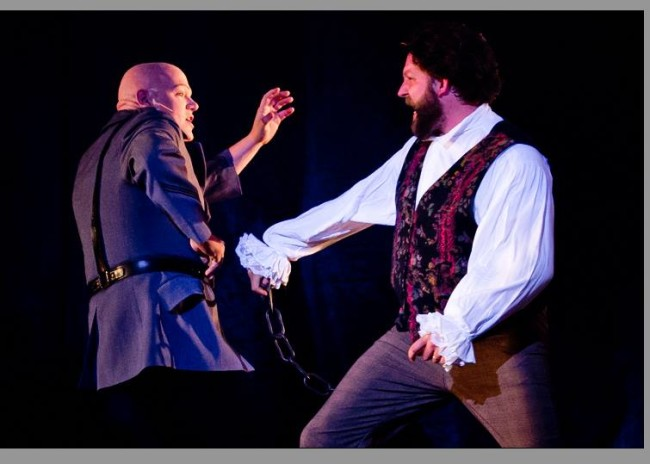 Lance Bankerd as Javert (left) and Lee Lewis as Jean Valjean (right) in Les Miserables at Milburn Stone Theatre