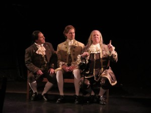 Jeffrey Shankle as John Adams (left) Brendan McMahon as Thomas Jefferson (center) and John Stevenson as Ben Franklin (right)