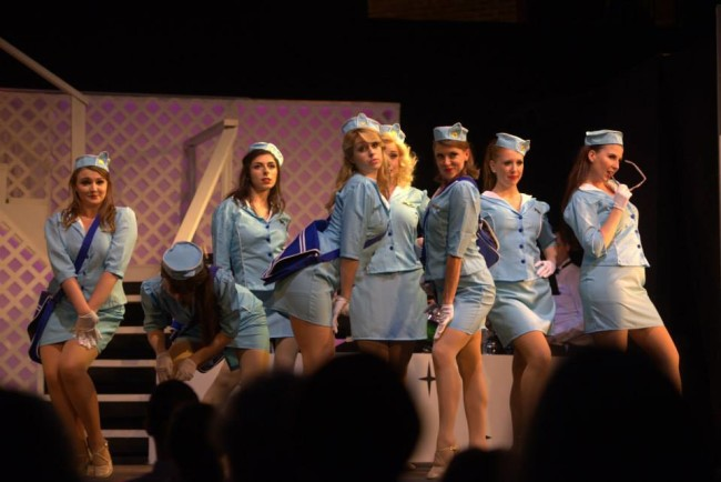 "The female ensemble as Pan-Am stewardesses in the number ""Jet Set"" in Catch Me If You Can"
