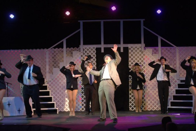 Joshua Mooney (center) as Carl Hanratty and the Frank Abagnale Jr. singers and dancers