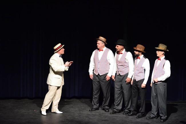 Professor Harold Hill (L- E. Lee Nicol) and The Quartet (R- Harbor City Barbershop Quartet)