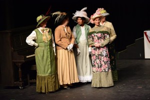 Female Ensemble Members in the glorious costumes by Lynn Kellner and marvelous hats by Mary Gorman