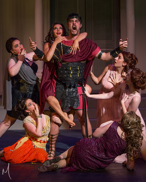 Matt Cannon (center) as Miles Gloriosus with the courtesans of Marcus Lycus